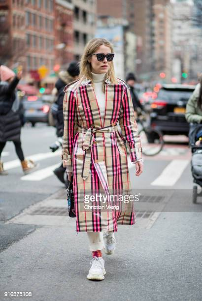 Annabel Rosendahl wearing checked Burberry coat seen outside Tory Burch on February 9 2018 in New York City