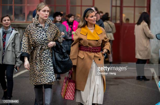 Annabel Rosendahl wearing coat with leopard jacket and Janka Polliani seen wearing belted beige coat pleated skirt bag with print Coach seen outside...