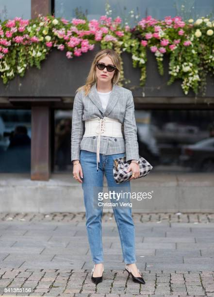 Annabel Rosendahl wearing grey blazer corset denim jeans outside Jennifer Bloom on August 31 2017 in Stockholm Sweden