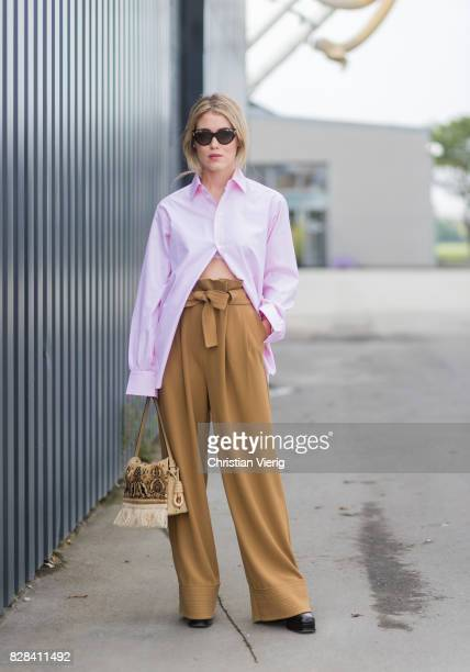 Annabel Rosendahl wearing high waisted brown pants pink button shirt outside By Malene Birger on August 09 2017 in Copenhagen Denmark
