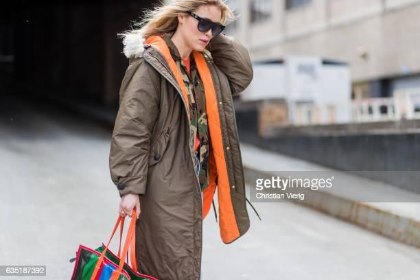 Annabel Rosendahl wearing parka denim jeans Balenciaga bag outside Proenza Schouler on February 13 2017 in New York City