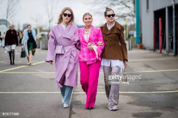 Annabel Rosendahl wearing pink coat and Janka Polliani wearing pink suit and Darja Barannik wearing brown jacket outside Designers Remix during the...