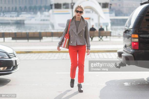 Annabel Rosendahl wearing red cropped pants checked grey blazer jacket outside House of Dagmar on August 31 2017 in Stockholm Sweden