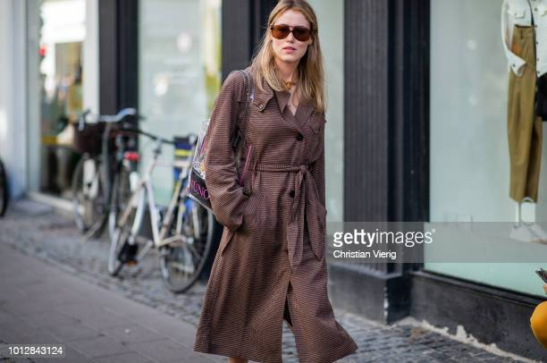 Annabel Rosendahl wearing see through sherr bag brown belted trench coat seen outside Blanche during the Copenhagen Fashion Week Spring/Summer 2019...