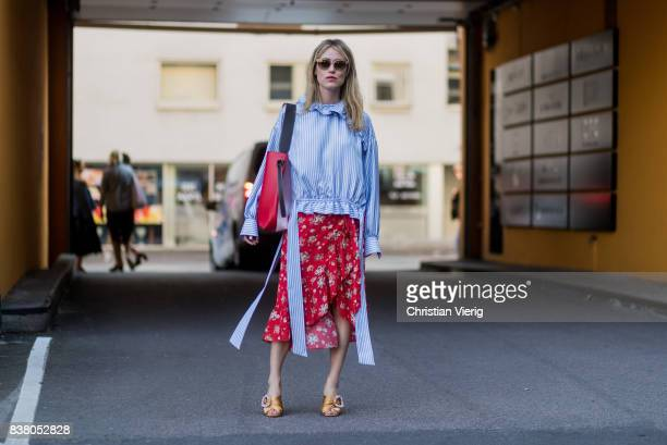 Annabel Rosendahl wearing striped button shirt red dress outside FWSS on August 23 2017 in Oslo Norway