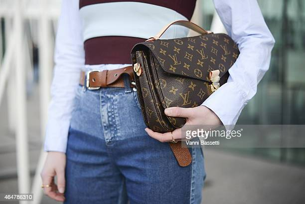 Annabel Rosendhal poses wearing Stella McCartney top and pants and Louis Vuitton bag on February 28 2015 in Milan Italy