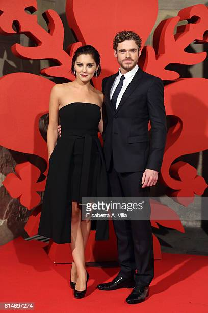 Annabel Scholey and Richard Madden walk a red carpet for 'I Medici' at Palazzo Vecchio on October 14 2016 in Florence Italy