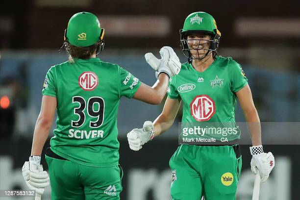 Annabel Sutherland and Nat Sciver of the Stars celebrate victory during the Women's Big Bash League WBBL Semi Final match between the Melbourne Stars...