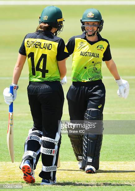 Annabel Sutherland of Australia and Nic Carey of Australia celebrate the wining runs during the ICC Women's T20 Cricket World Cup Warm Up match...
