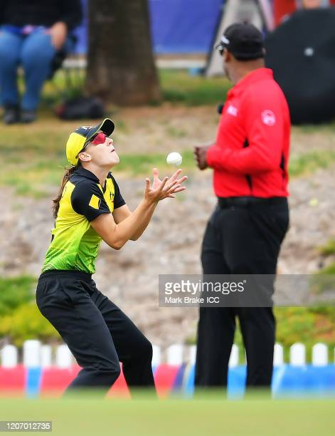 Annabel Sutherland of Australia catches Sune Luus of South Africa during the ICC Women's T20 Cricket World Cup Warm Up match between Australia and...