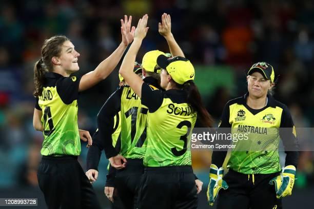Annabel Sutherland of Australia celebrates dismissing Sanjida Islam of Bangladesh with team mates during the ICC Women's T20 Cricket World Cup match...