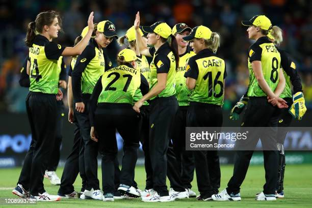 Annabel Sutherland of Australia celebrates dismissing Sanjida Islam of Bangladesh with team mates during the ICC Women's T20 Cricket World Cup match...
