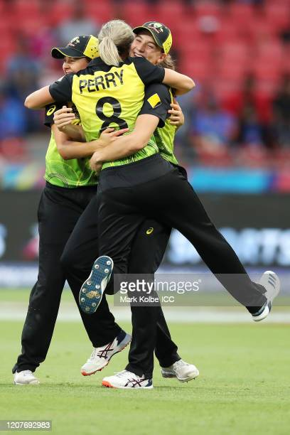 Annabel Sutherland of Australia celebrates with Ellyse Perry and Molly Strano of Australia after taking the catch to dismiss Shafali Verma of India...