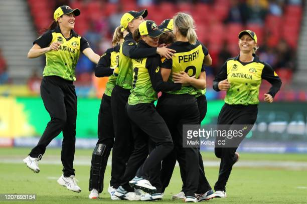 Annabel Sutherland of Australia celebrates with her team after taking the catch to dismiss Shafali Verma of India during the ICC Women's T20 Cricket...