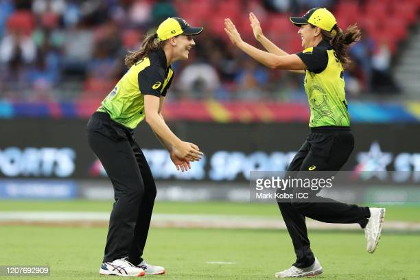Annabel Sutherland of Australia celebrates with Molly Strano of Australia after taking the catch to dismiss Shafali Verma of India during the ICC...