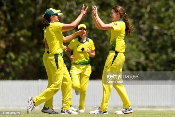 Annabel Sutherland of Australia celebrates with team mates after dismissing Shafali Verma of India during the first Women's Twenty20 match between...