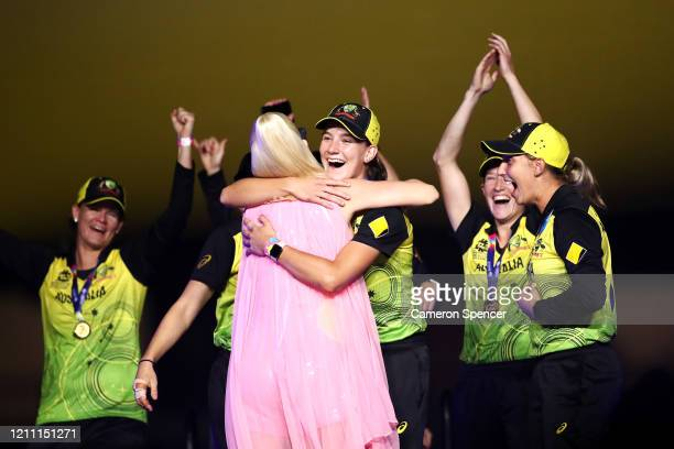 Annabel Sutherland of Australia hugs Katy Perry on stage during her concert after Australia's victory in the ICC Women's T20 Cricket World Cup Final...