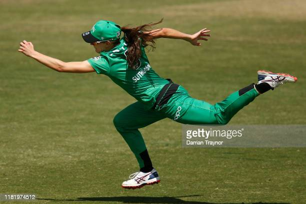 Annabel Sutherland of the Melbourne Stars dives for the ball during the Women's Big Bash League match between the Hobart Hurricanes and the Melbourne...