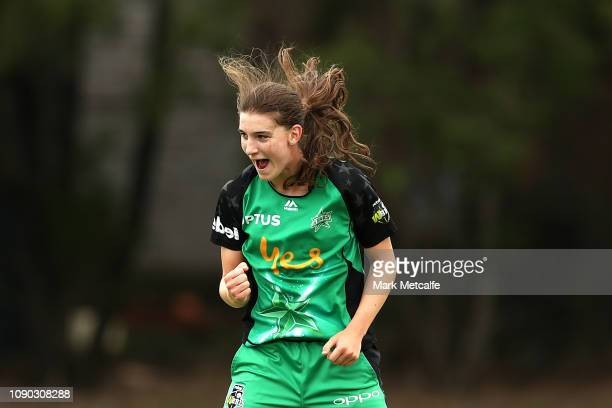 Annabel Sutherland of the Stars celebrates taking the wicket of Harmanpreet Kaur of the Thunder during the Women's Big Bash League match between the...