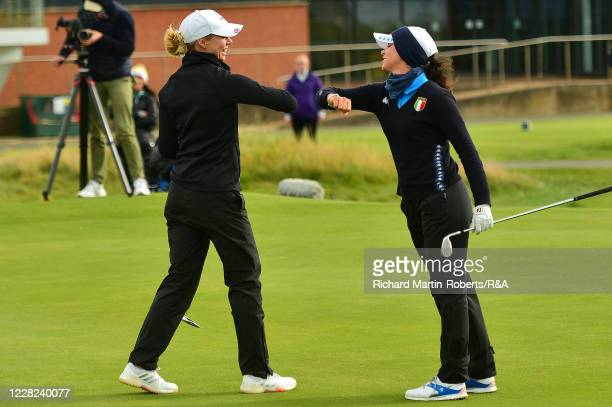 Annabell Fuller of England elbow bumps with Alessia Nobilio of Italy after her victory during the Quarter Finals on Day Four of The Women's Amateur...