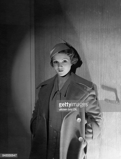 Annabella Actress France*nee Suzanne Georgette Charpentier Portrait in hat and jacket standing in front of a door 1932 Photographer Horst P Horst...