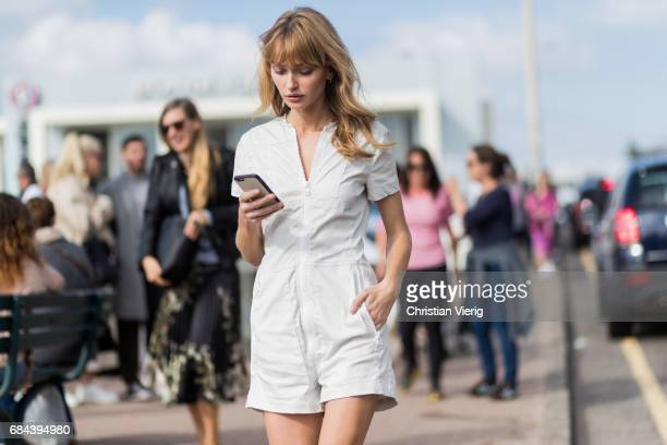 Annabella Barber wearing a white jumpsuit outside Ten Pieces at day 5 during MercedesBenz Fashion Week Resort 18 Collections at Icebergs on May 18...