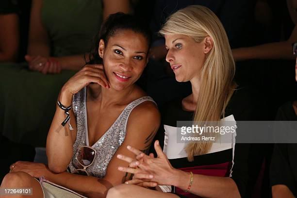 Annabella Mandeng and Natascha Gruen attend the Laurel Show during the MercedesBenz Fashion Week Spring/Summer 2014 at Brandenburg Gate on July 4...