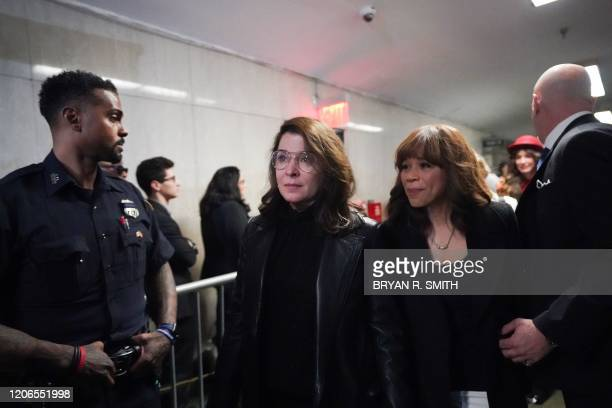 Annabella Sciorria and Rosie Perez leave the courtroom following the sentencing of movie producer Harvey Weinstein at Manhattan Criminal Court on...