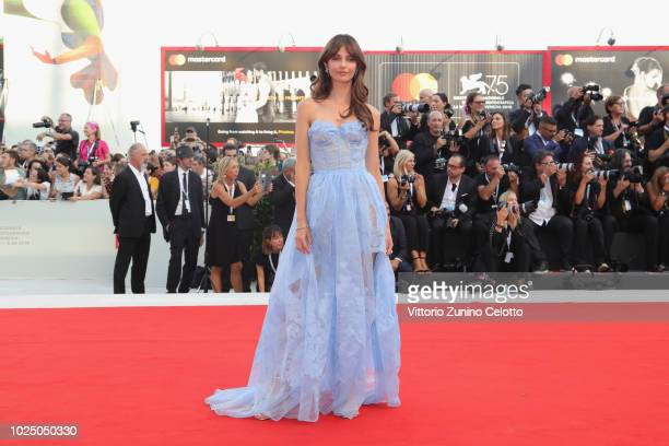 Annabelle Belmondo walks the red carpet ahead of the opening ceremony and the 'First Man' screening during the 75th Venice Film Festival at Sala...
