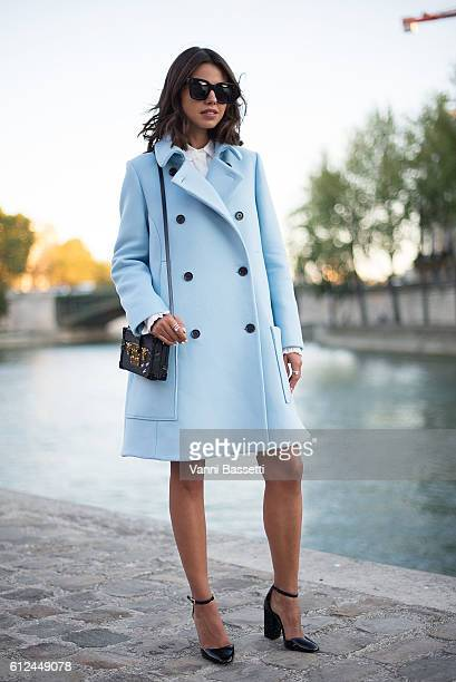 Annabelle Fleur poses wearing a Paul and Joe coat and a Louis Vuitton bag before the Paul and Joe show at Les Nautes during Paris Fashion Week SS17...