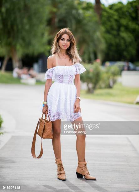Annabelle Fleur wearing off shoulder dress Dior bag ankle boots is seen at Revolve Festival on April 15 2018 in Indio California