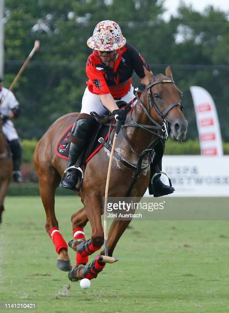 Annabelle Gundlach of Postage Stamp bring the ball up field against Pilot during the 2019 Captive One U.S. Open Polo Championship on April 7, 2019 at...