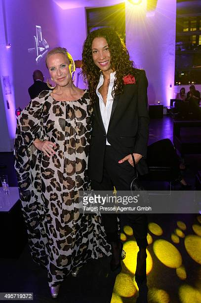 Annabelle Mandeng and Nadja Michael attend the SPECTRE by ST Dupont launch event on November 4 2015 in Berlin Germany