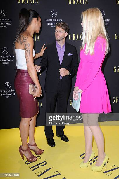 Annabelle Mandeng Kai Rose and Tanja Buelter attend the MercedesBenz Fashion Week Berlin Spring/Summer 2014 Preview Show by Grazia at the Brandenburg...