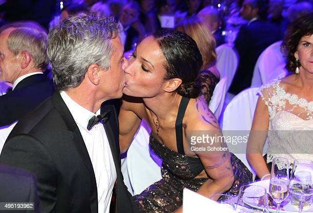 Annabelle Mandeng kisses her partner Hajo during the Leipzig Opera Ball 2015 on October 31 2015 in Leipzig Germany