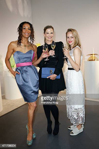Annabelle Mandeng Verena Wriedt and Esther Seibt attend the Hubert le Gall Vernissage At Ruinart PopUp Gallery on April 30 2015 in Berlin Germany