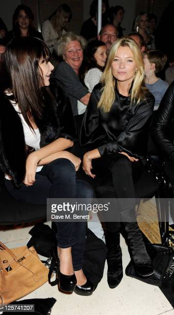 Annabelle Neilson and Kate Moss sit in the front row at the James Small Menswear Spring/Summer 2012 runway show during London Fashion Week at the...