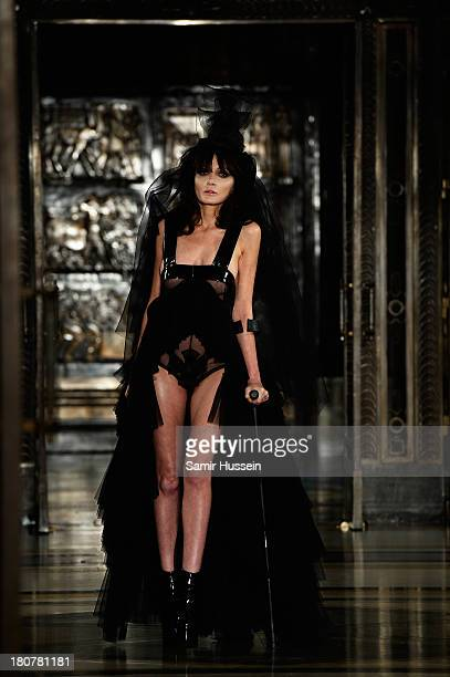 Annabelle Neilson walks the runway at the Pam Hogg show during at the Fashion Scout venue during London Fashion Week SS14 at Freemasons Hall on...
