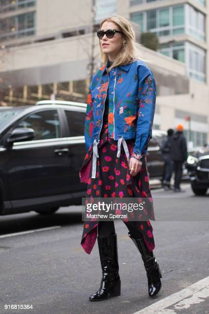 Annabelle Rosenthal is seen on the street attending SelfPortrait during New York Fashion Week wearing a blue jacket with black/pink skirt on February...