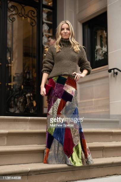 Annabelle Wallis is seen on the street during New York Fashion Week AW19 wearing brown knit sweater with patchwork skirt on February 07 2019 in New...