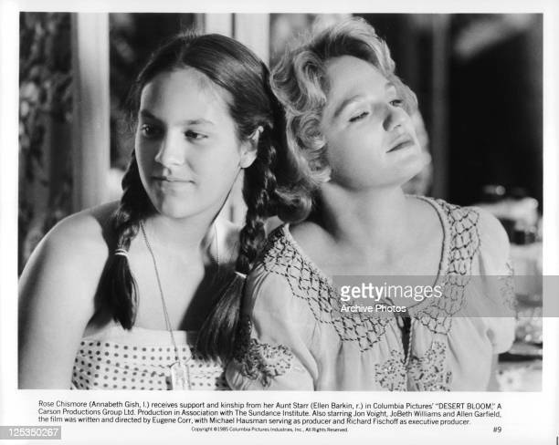 Annabeth Gish And Ellen Barkin lean against each other in a scene from the film 'Desert Bloom' 1985