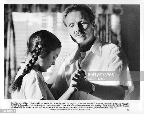 Annabeth Gish And Jon Voight dance in a scene from the film 'Desert Bloom' 1985