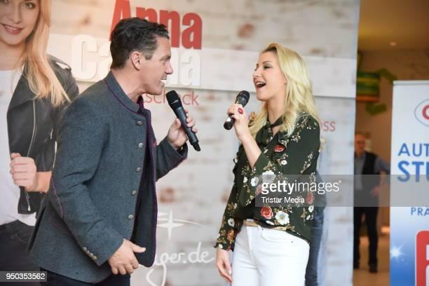AnnaCarina Woitschack and her boyfriend Stefan Mross promote their new album 'Liebe passiert' at Lausitz Park shopping mall on April 23 2018 in...