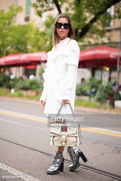 Annacarla dall'Avo poses wearing Louis Vuitton boots and Gucci bag after the Fendi show during Milan Fashion Week Spring/Summer 2017 on September 22...