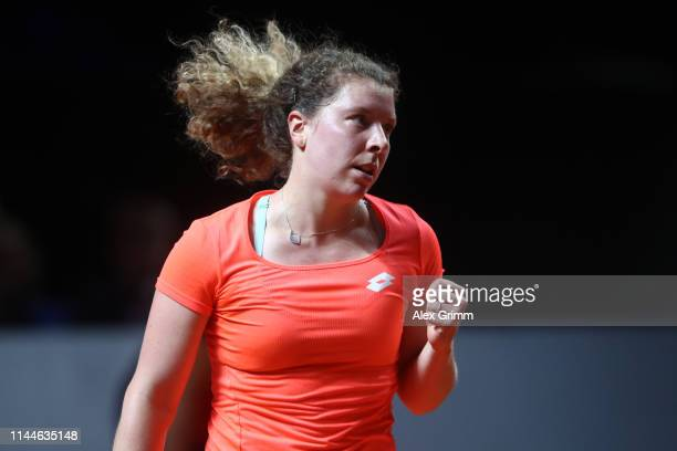 AnnaLen Friedsam of Germany celebrates a point during her first round match against Kiki Bertens of Netherlands on day 2 of the Porsche Tennis Grand...