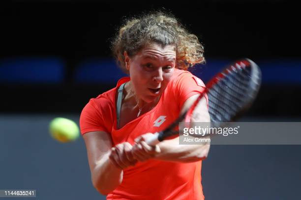 AnnaLen Friedsam of Germany plays a backhand to Kiki Bertens of Netherlands during their first round match on day 2 of the Porsche Tennis Grand Prix...