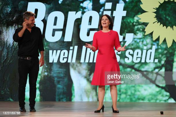 Annalena Baerbock and Robert Habeck, co-heads of the German Greens Party, smile after delegates at the Greens Party virtual party congress confirmed...