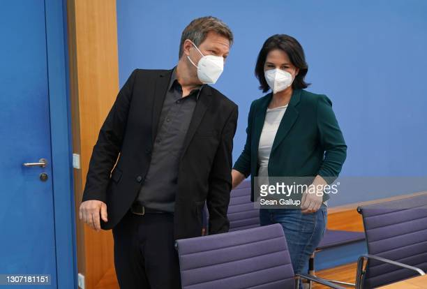 Annalena Baerbock and Robert Habeck, co-leaders of the German Greens party, depart after speaking to the media the day after elections in the states...