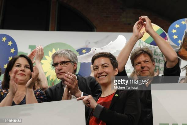 Annalena Baerbock Chairwoman Sven Giegoldl Ska Keller colead candidates for the German Greens Party Robert Habeck Chairman wave to delegates at a...