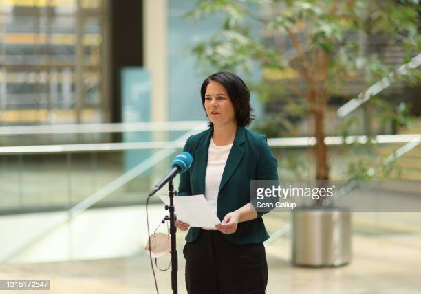 Annalena Baerbock, chancellor candidate and co-leader of the German Greens Party, speaks to the media after Germany's Constitutional Court deemed...